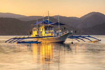 Cuilon Island sunrise - The beautiful golden light of a peaceful sunrise on Culion Island in the Philippines.