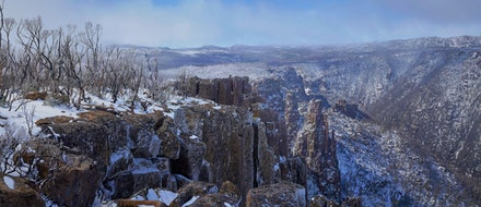 Devils Gullet - Located on Tasmania's Central Plateau, Devil's Gullet features dramatic views into a steep, narrow glacial gorge formed by vertical dolerite...
