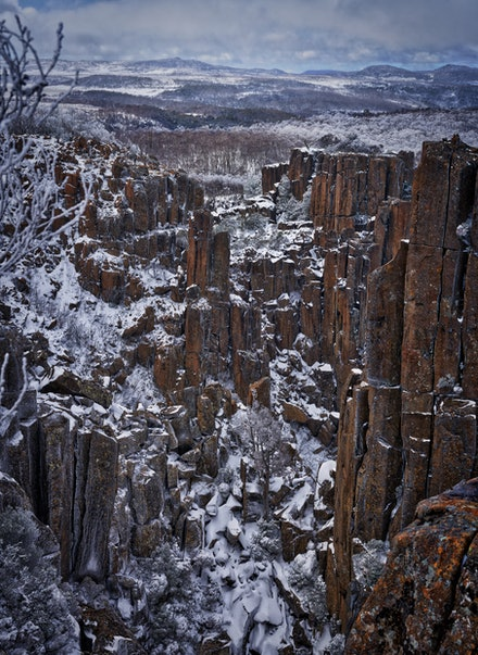 Devils Gullet 2 - Located on Tasmania's Central Plateau, Devil's Gullet features dramatic views into a steep, narrow glacial gorge formed by vertical dolerite...