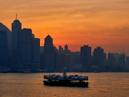 Star Ferry sunset - The end of another beautiful winters day as the sun sets behind Hong Kong Island, and the famous Star Ferry makes another trip across...