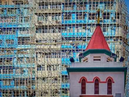Hong Kong Sheng Kung Hui All Saints' Cathedral - The spire of the Hong Kong Sheng Kung Hui All Saints' Cathedral against a back drop of Hong Kong's 'infamous'...