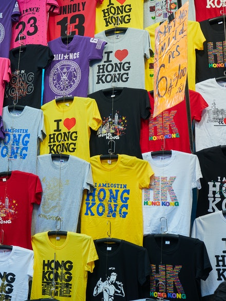 T-shirts T-shirts everywhere!! - The markets of Hong Kong are a great place to grab cheap souvenirs for friends back home. The choice is simply amazing.