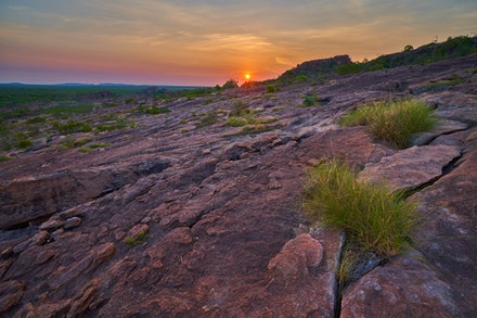 Nawurlandja sunset - The sun sets behind the Nawurlandja lookout in Kakadu National Park.