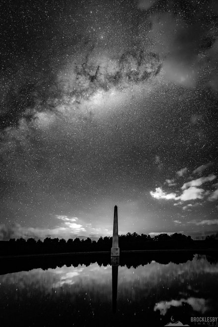 Mayfield Gardens Obelisk - A black and white stitched panorama of the Southern Hemisphere  Milky Way over the Obelisk at Mayfield Gardens, Oberon NSW.