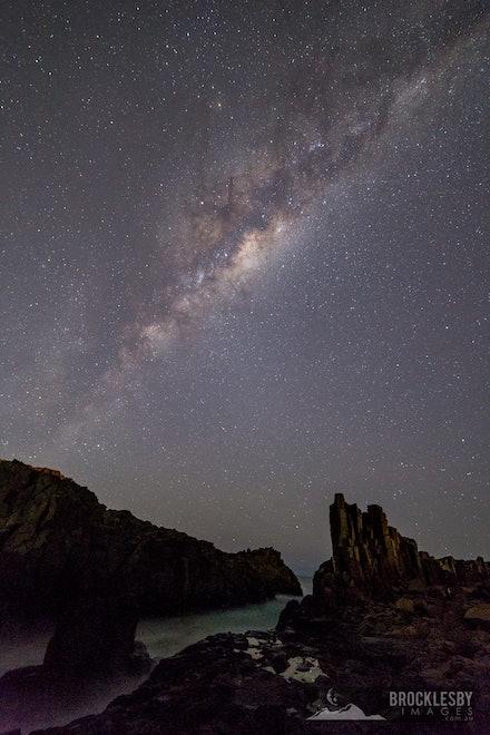 Rugged coastline Milky Way - The milky way arches away over Bombo Quarry, Kiama, NSW.