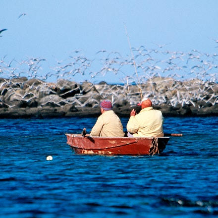 Two men and a dingy. - Fishing for Gar Fish at Pea Soup in Port Fairy,South West Victoria, Australia.