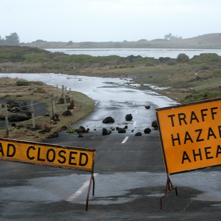 Rocks litter the road. - Rocks and the ocean all over the road from the Passage toward the centre of town after huge seas in Port Fairy, South West Victoria,...